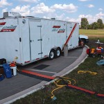 The broadcast trailer on the road.